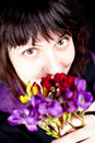 Woman with purple flower Stock Images