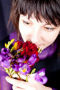 Woman with purple and red flowers Stock Image