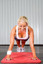 Woman push ups Stock Image
