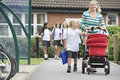 A woman with a pushchair with her son Royalty Free Stock Photo