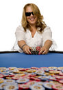 Woman pushes poker chips on blue felt table Royalty Free Stock Photo
