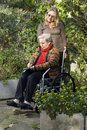 Woman Pushing Mother in Wheelchair - Vertical Stock Photography