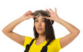 Woman put on safety goggles. Royalty Free Stock Photo