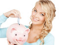 Woman puts cash money into big piggy bank buisness banking and savings concept happy businesswoman Stock Images