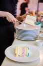 Woman putting cake slices on plates celebration Stock Photography