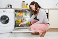 Woman Putting Detergent Tablet In Dishwasher Royalty Free Stock Photo