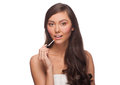 Woman putting on lip gloss Royalty Free Stock Image