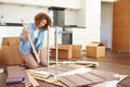 Woman putting together self assembly furniture in new home kitchen Royalty Free Stock Photos