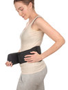 Woman putting wrapped sports medical belt, corset Royalty Free Stock Photo