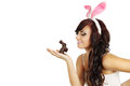 Woman rabbit ears holds chocolate bunny Stock Photos