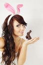 Woman rabbit ears holds chocolate bunny Royalty Free Stock Image