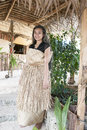 Woman with raffia dress in tonga young and typical ifrom Royalty Free Stock Image