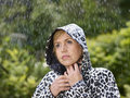 Woman and raincoat mature wearing rainy summer day green nature on background Stock Images