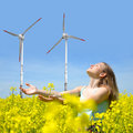 Woman on rapeseed field Royalty Free Stock Photo
