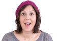 Woman reacting in delight and pleasure attractive a knitted cap with sparkling eyes her mouth open wide isolated on white Royalty Free Stock Photos