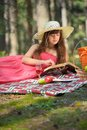 Woman read book and enjoying outdoor picnic smiling young reading in summer day Stock Image