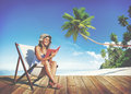 Woman Reading on Beach Relaxation Resting Concept Royalty Free Stock Photo