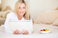 Woman reading on bed Royalty Free Stock Image
