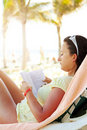 Woman reading book on the Caribbean beach Royalty Free Stock Image