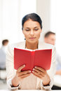 Woman reading book in college or office Royalty Free Stock Photo