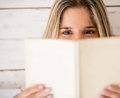 Woman reading a book eagerly Stock Image