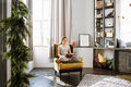 Woman reading book at home in the living room Royalty Free Stock Photo