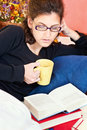 Woman reading book at home young Stock Photo