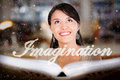 Woman reading a book and letting her imagination fly Royalty Free Stock Photo