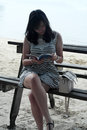 Woman Reading Book at Seaside Royalty Free Stock Photo