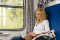 Woman reading book in train smiling commuter Royalty Free Stock Photos