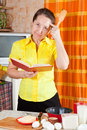 Woman reading cookbook Stock Images