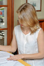 Woman reading documents at table in cafe Stock Photo