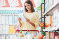 Woman reading food labels Royalty Free Stock Photo