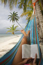 Woman Reading in a Hammock Royalty Free Stock Images