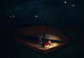 Woman reading inside huge bible a is a at night under the stars Stock Images
