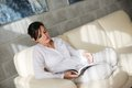 Woman reading magazine at home happpy young magazina in comfortabel sofa and bright living room Royalty Free Stock Photo