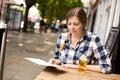 Woman reading menu young the at a bar Royalty Free Stock Images
