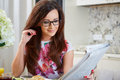 Woman reading a newspaper Royalty Free Stock Photo