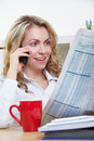 Woman reading newspaper and making Royalty Free Stock Photos