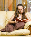 Woman reading novel Stock Images