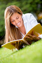 Woman reading outdoors Royalty Free Stock Photography