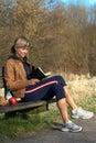 Woman Reading Outdoors Stock Photos