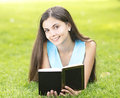 Woman reading outdoors summer a book and relaxing Royalty Free Stock Photo