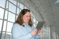 Woman reading a surprise on your tablet Stock Photos