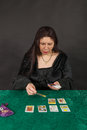 A woman is reading tarot cards Stock Photos