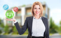 Woman real estate agent holding buy sell and rent offers on residential house background Royalty Free Stock Image