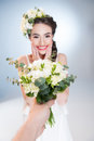 Woman receiving flowers Royalty Free Stock Photo