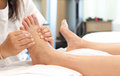 Woman receiving a foot massage and relaxing at the health spa Royalty Free Stock Photos