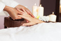 Woman receiving a hand massage at the health spa Royalty Free Stock Photo
