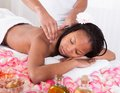 Woman receiving massage at spa portrait of in Stock Photo